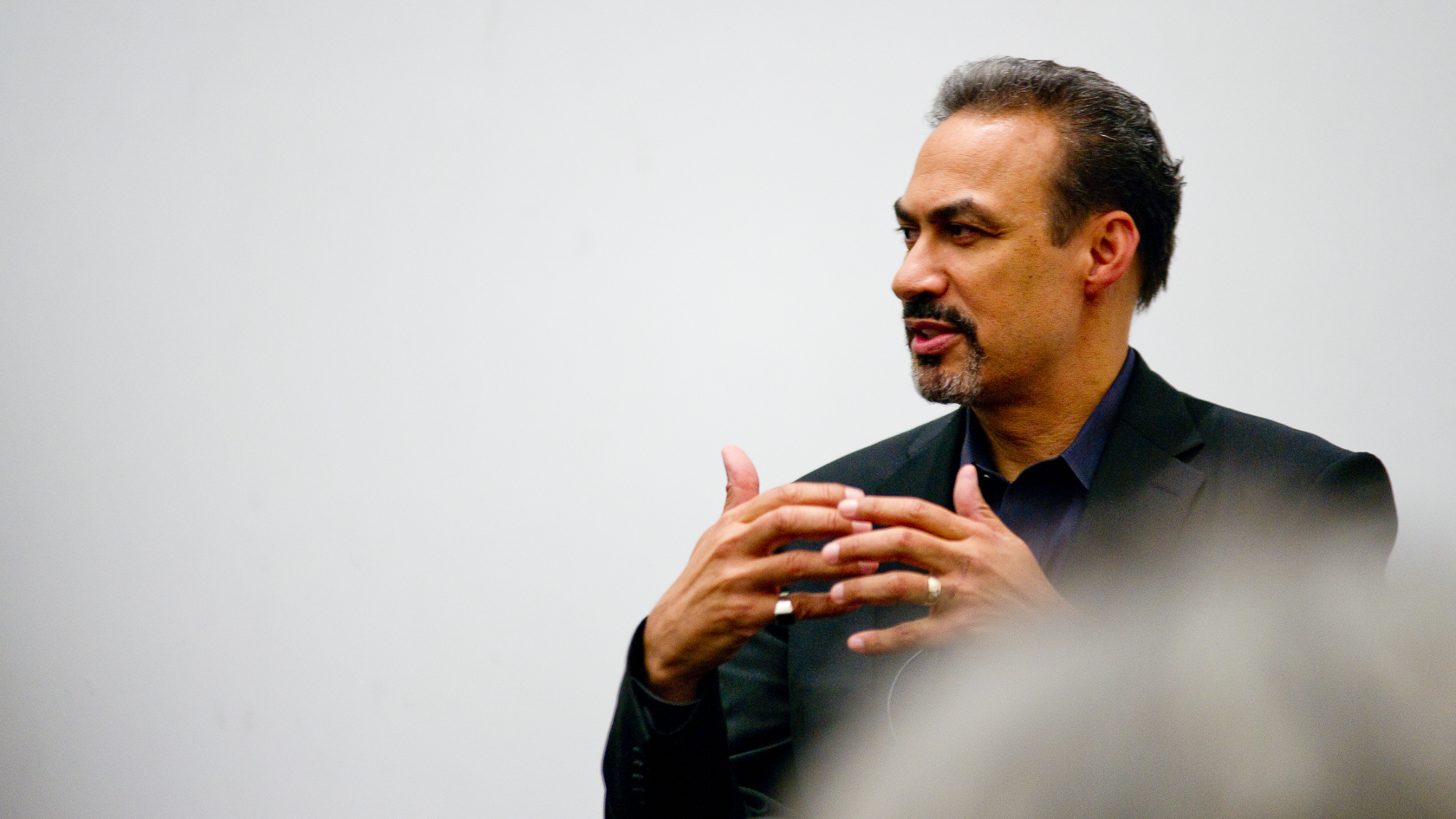 Portrait of Mr. Freelon speaking at a Harvard lecture, 2010